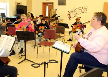 OAHS guitar class resonates with music educators
