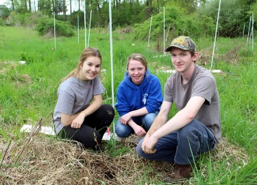 OAHS students plant trees to buffer creek